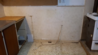 The buggered wall and floor
